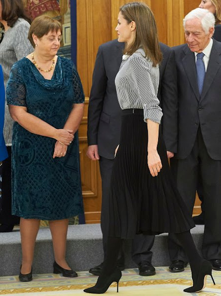 Queen Letizia wore Hugo Boss line Blouse, Magrit pumps and Boss black plated skirt, newmyroyals
