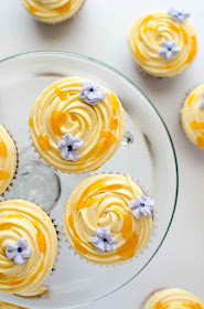 cupcakes topped with apricot frosting