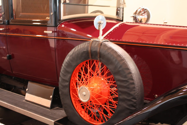 Close up of mirror on wheel of coachbuilt car