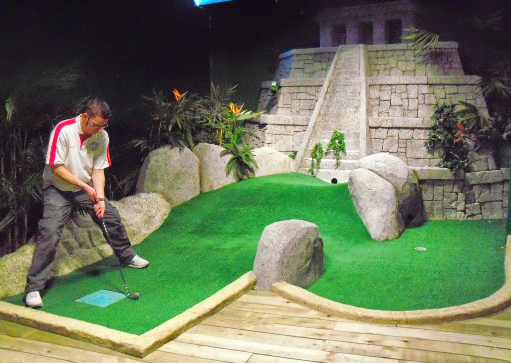 Minigolfer Richard Gottfried playing the Jungle Rumble indoor adventure golf course at the Liverpool ONE shopping centre
