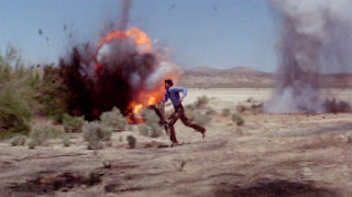 Tanner (George Hamilton) runs from strafing air force jets