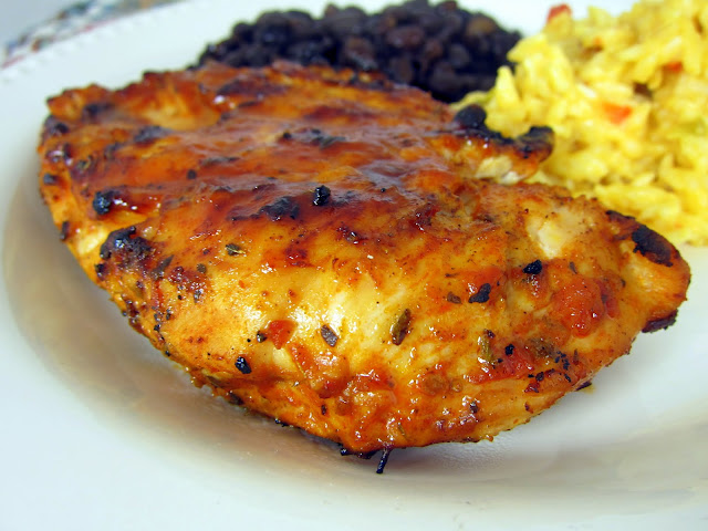 Taco Chicken Recipe - chicken breasts marinated in taco seasoning, oregano, olive oil, salsa, and cumin - grill or pan sear and brush with a mixture of BBQ sauce and chili sauce - AMAZING! I wanted to lick my plate! Great in tacos and salads.