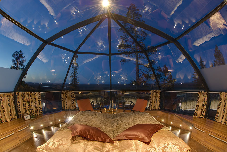 14 Crazy Hotels That Will Give You Serious Travel Goals - Hotel Kakslauttanen in Finland gives guest the chance to stay the night in an updated igloo. This hotel is most popular during the Aurora Borealis, where guests get the best seats in the house.
