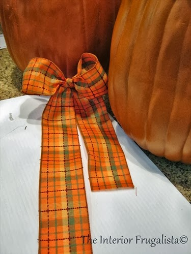 Make a simple bow with wide Fall ribbon.