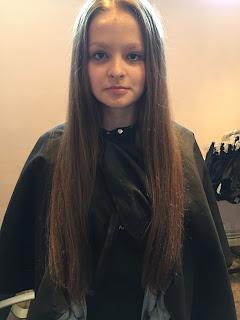 Ellie Bate before donating her hair