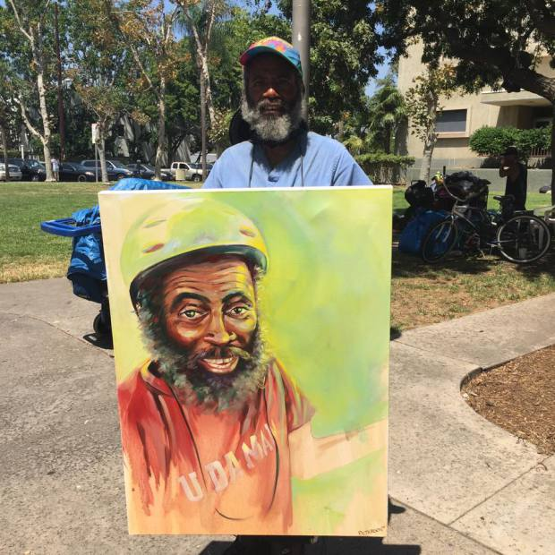 Meet The Artist Who Paints And Sells Portraits Of Homeless People, Giving Them The Profits - Daryl with his painting