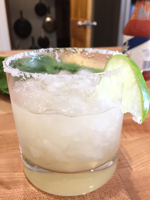 A margarita on crushed ice with a lightly salted rim