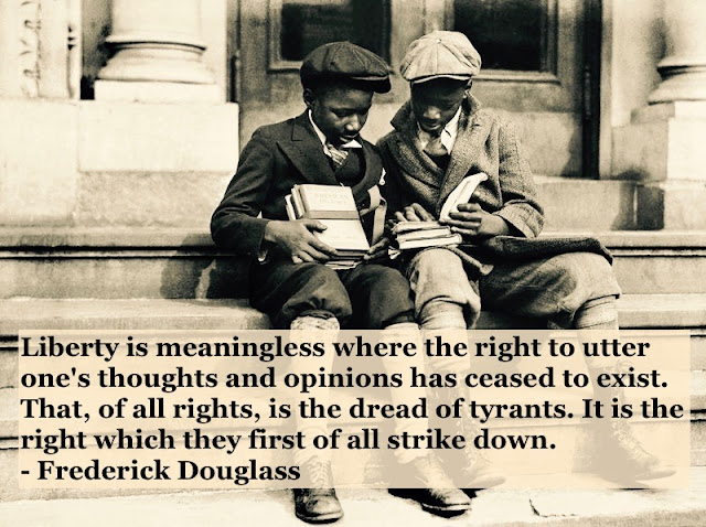 Photo of two young black school boys sharing a book on the building steps. c 1910s Liberty and rights quote by Fredrick Douglass. Other stories of Racism and Civil Rights. Well said, Mr. Douglass. marchmatron.com