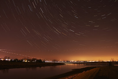 star trails with airplane lights