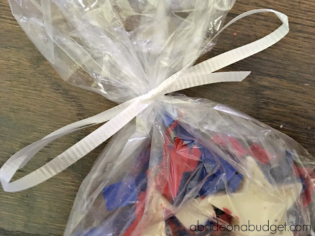 A perfect patriotic wedding favor are these Homemade Red, White, And Blue Chocolate Star Wedding Favors. Find out how to make them at www.abrideonabudget.com. You can change them to your wedding colors as well.