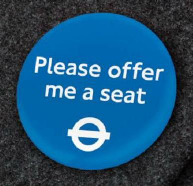 Badge that reads please offer me a seat