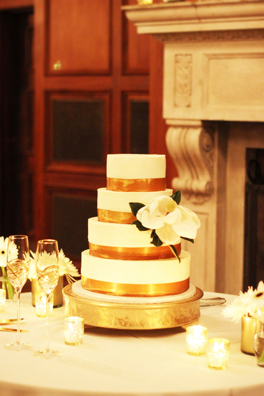 4 tiered wedding cake with magnolia flower
