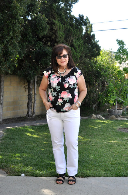 fashion white jeans and black floral blouse