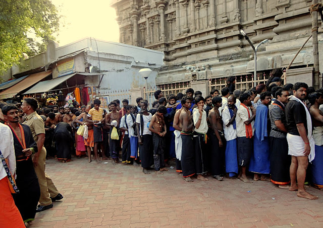 ayyappa devotees in a line outside temple