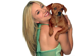 Kaley Cuoco with cute smile dog hd images