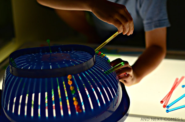 Fine motor light table activity for kids from And Next Comes L