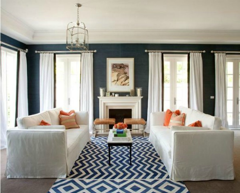 Navy walls, coastal space, white slipcover sofas, navy and white chevron rug