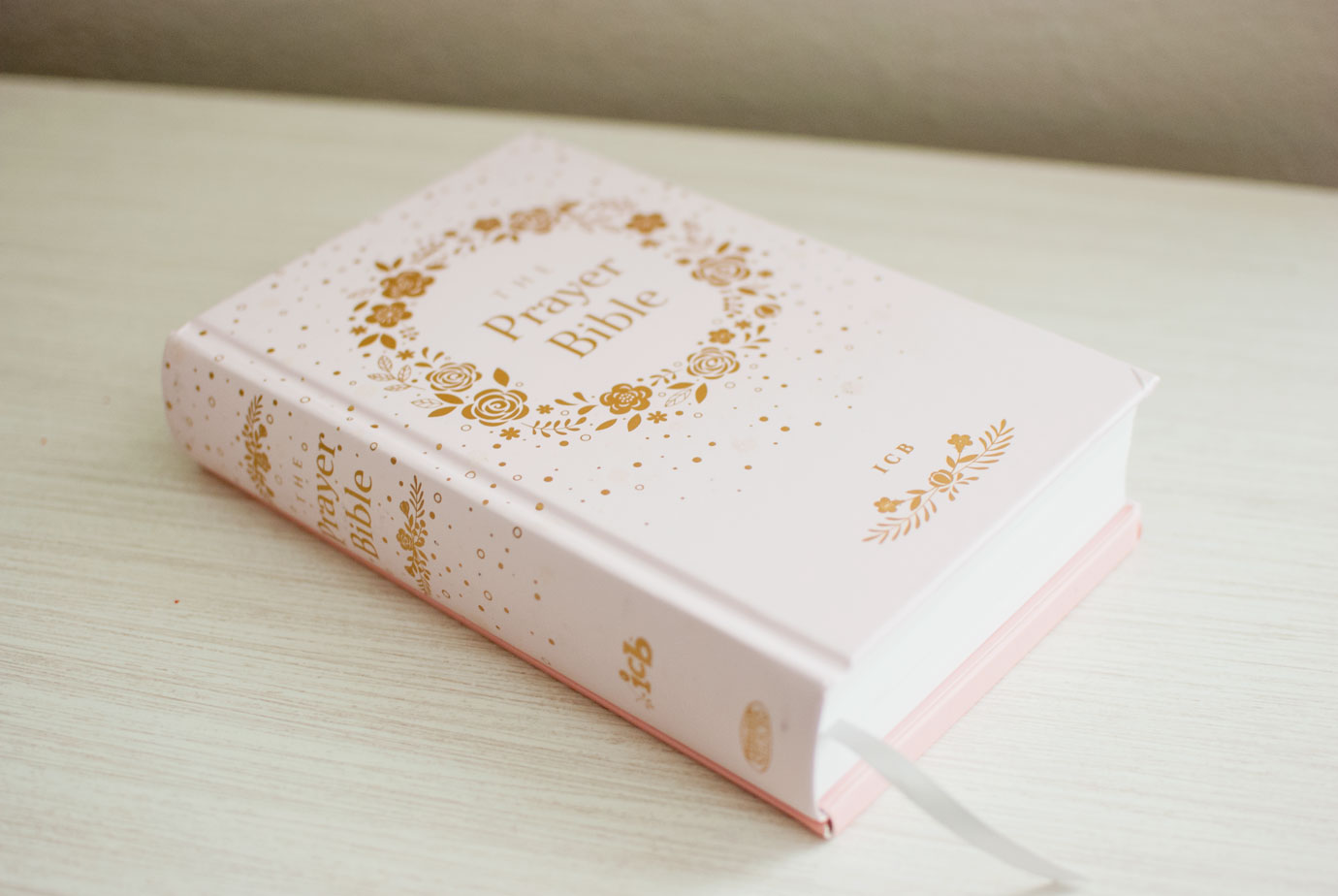 The ICB Prayer Bible For Children has a pink and gold floral design with a hard cover #ICBPrayerBible