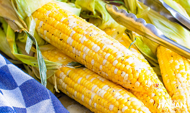 Smoked Corn on the Cob with tongs