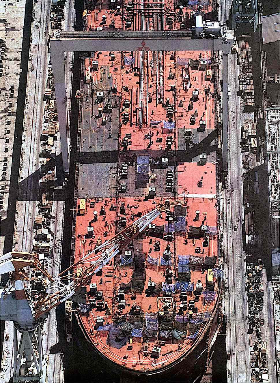 a George Gerster photograph of a ship in dry dock, from a birdseye view