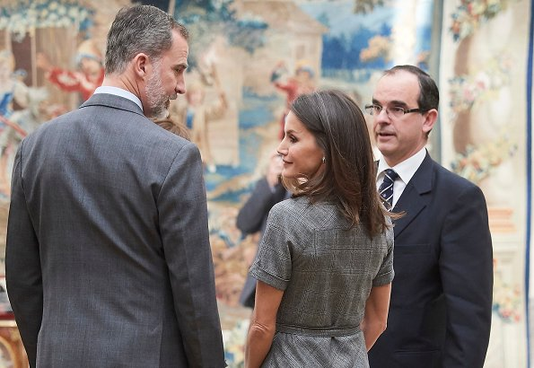 Queen Letizia wore Massimo Dutti wool check belted dress