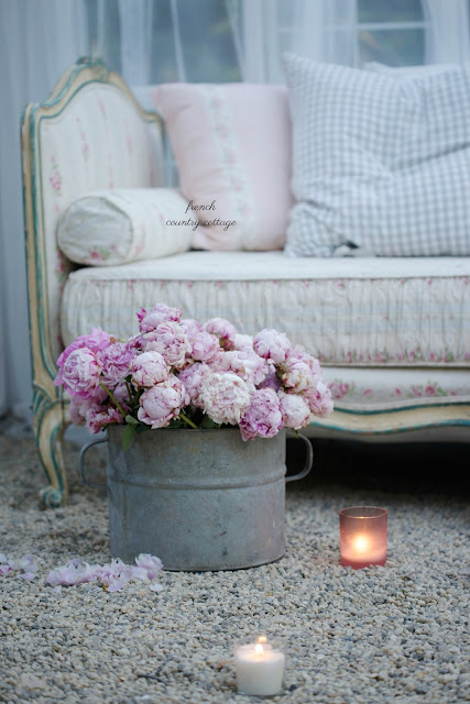 bucket of flowers with a vintage french daybed