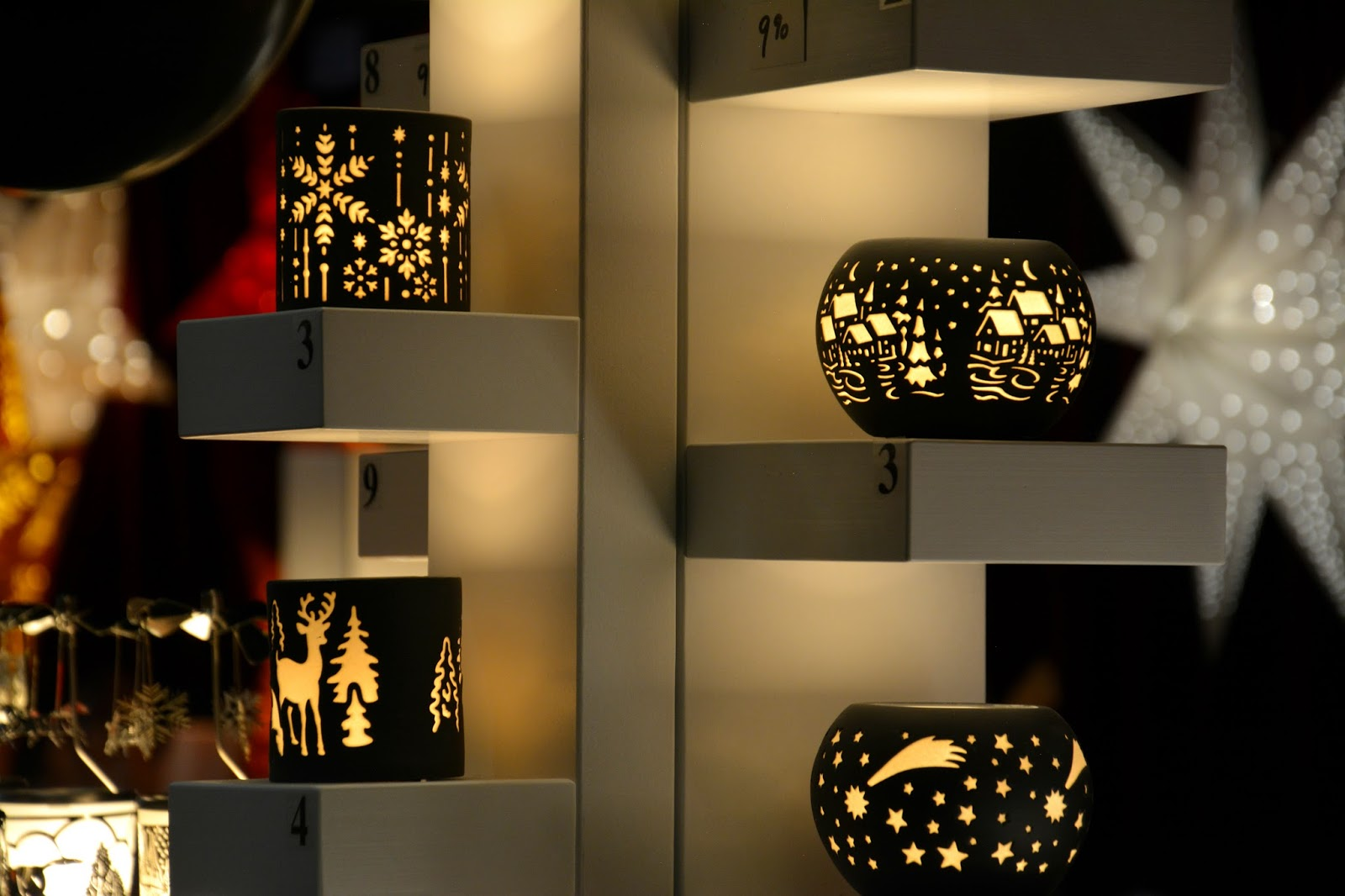 handmade candle lights with festive patterns