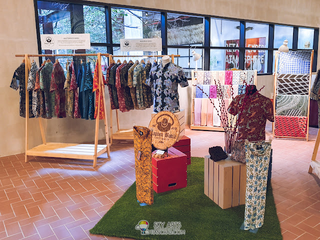 Striking color and batik print wear available near the rainbow stairs