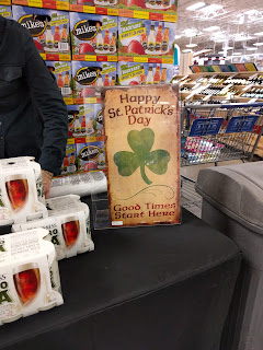 samples and sign at Sam's Club on St Patrick's Day
