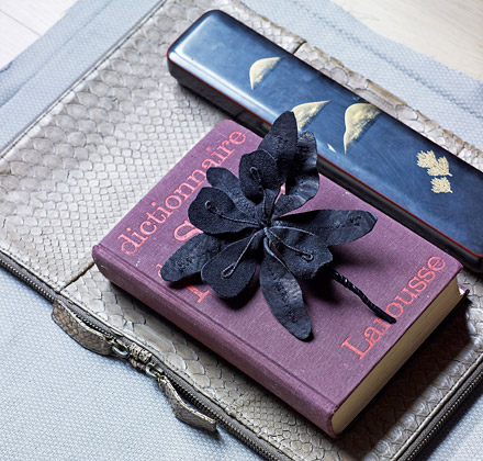 Purple dictionary blue flower and leather in stylish chic vignette Karin Meyn
