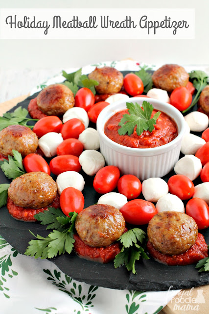 This easy to make, yet elegant Holiday Meatball Wreath Appetizer is sure to steal the show at your next holiday party or get-together.