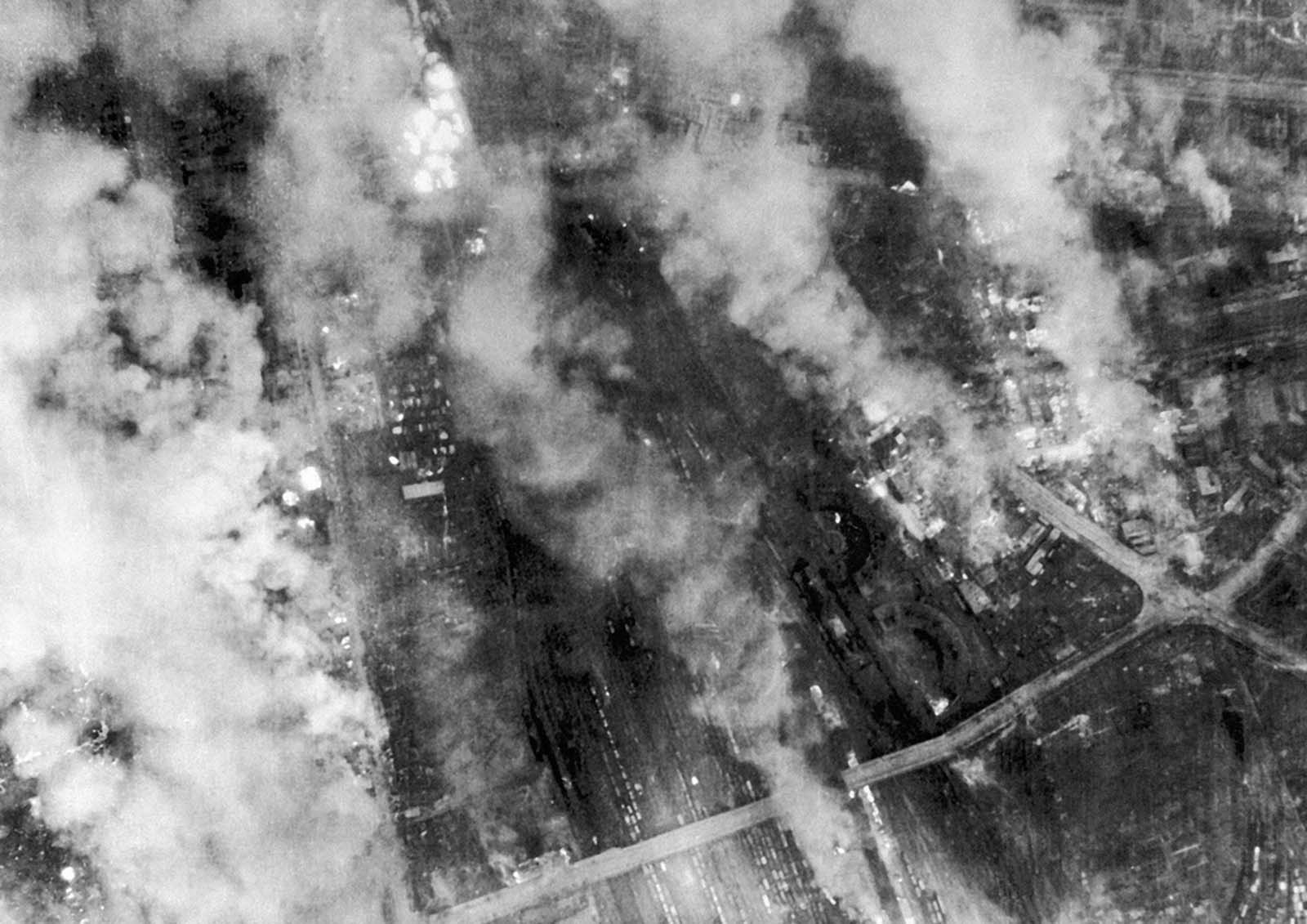 In this British Official Photo, on the night of February 13 and the morning of February 14, 1945, Lancasters of R.A.F. Bomber Command made two very heavy attacks on Dresden, Germany. Heavy bombers of the U.S. 8th Air Force attacked this target the following day. The smoke from fires still burning drifted across Dresden on February 14, 1945.