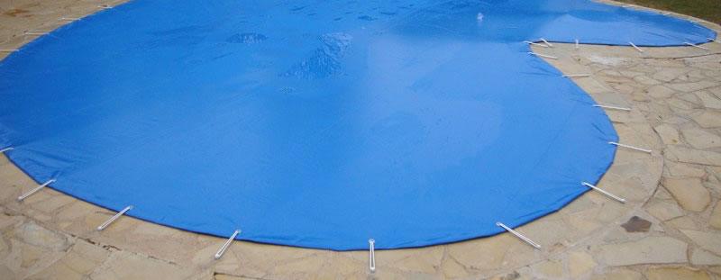 Los cobertores de protección de piscinas para invierno. De venta en Espool Piscinas.