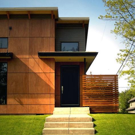 un enchapado de madera en forma de cubos y un cerco de casa al costado que forma parte del diseo lineal por giulietti schouten architects