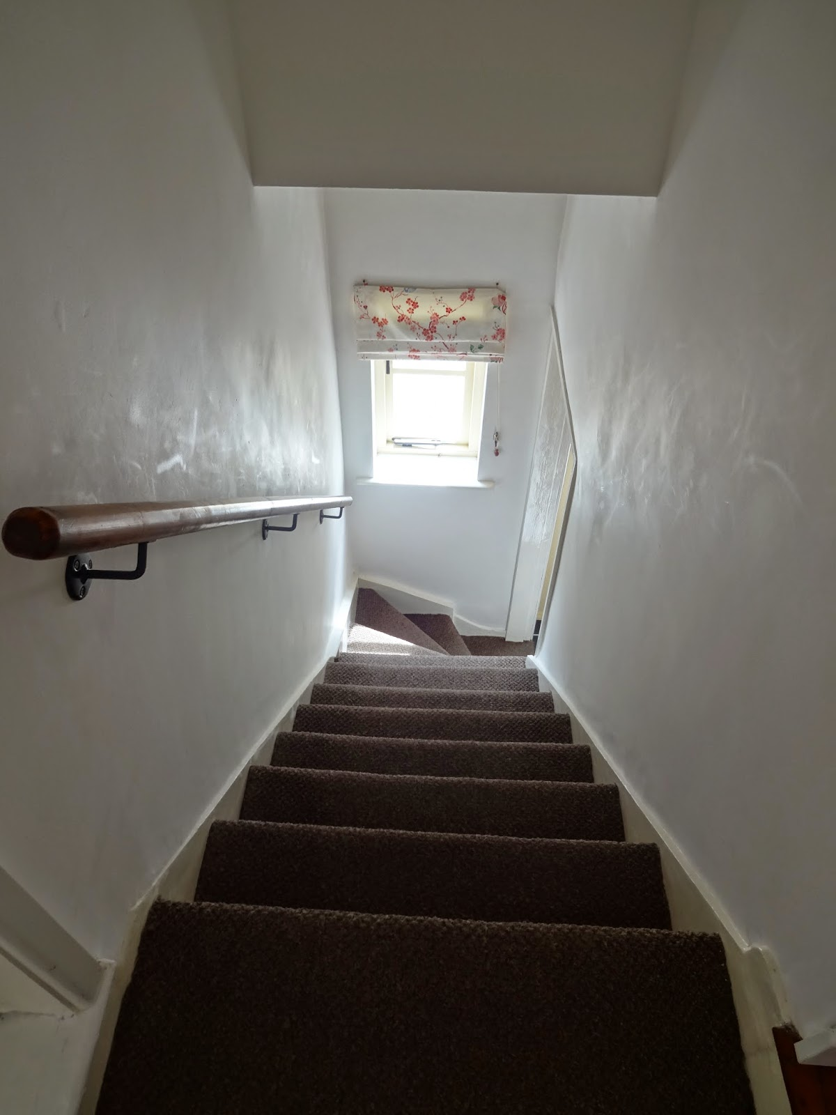 staircase in victorian terrace with small window