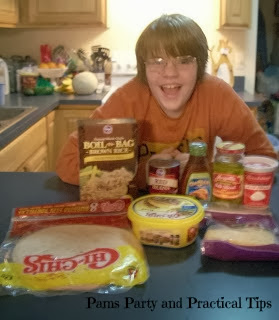 Kyle with the ingredients needed for his Cooking with Kyle burritos