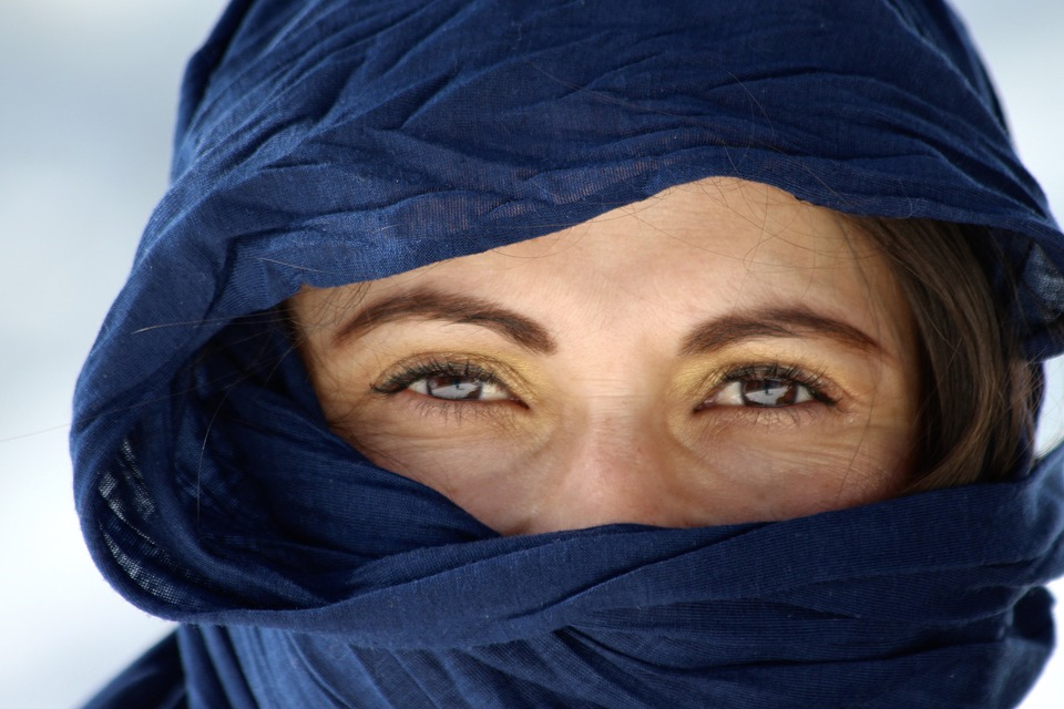 Woman with her face covered