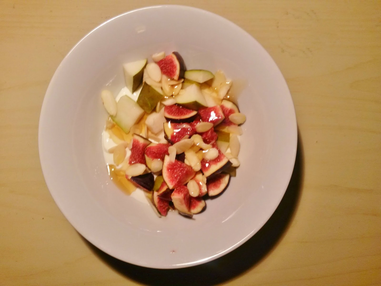 Yoghurt topped with fig, pear, honey and almonds