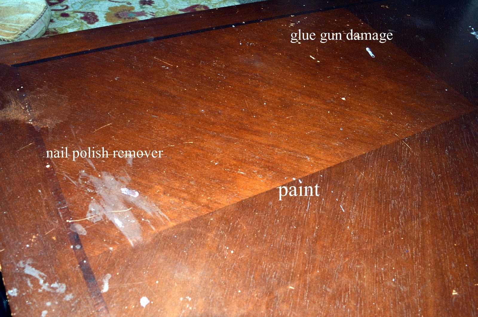 Spilled Nail Polish Remover On Painted Wood Table
