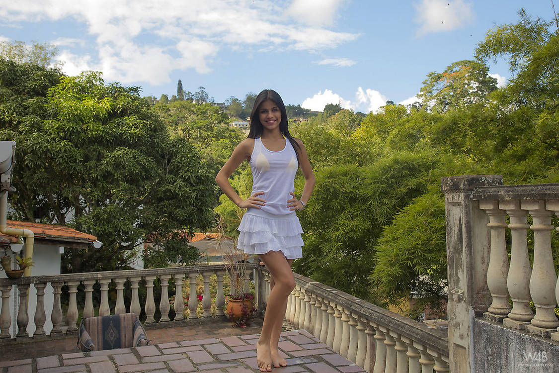 Smiley Small Boobs Brunette Denisse Gomez Drops Her Lace Skirt On The Balcony To Pose Nude