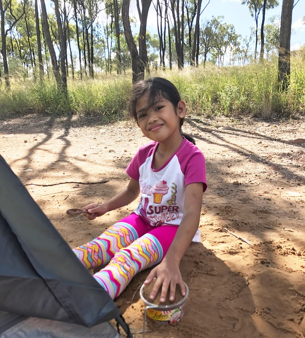 kid enjoying camping at queensland lake