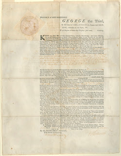 A color scan of the charter for the town of Hanover. The text is printed with some handwritten elements and King George the Third's name is prominently displayed.