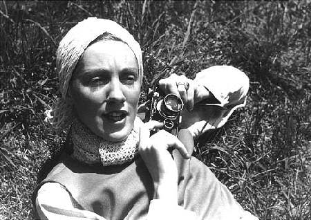 """I'd Rather Stalk with a Camera Than a Gun"", photo of American photographer Toni Frissell, c. 1935"