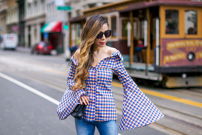 Caroline constas Persephone Blouse, off shoulder plaid blouse, bell sleeve blouse, ripped jeans, karen walker sunglasses, baublebar earrings, chanel classic flap bag, aquazzura amazon pumps, lace up pumps, san francisco fashion blog, san francisco street style, spring outfit ideas