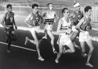 Abebe Bikila (left) during the opening stages of the  marathon at the 1960 Rome Olympics
