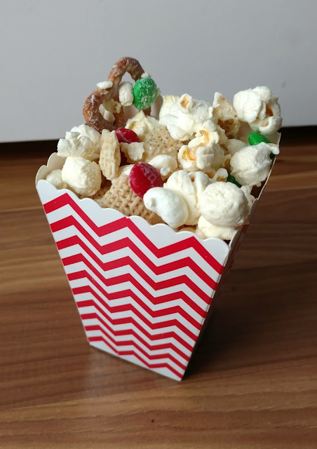 What do you get when you mix white chocolate, popcorn, pretzels, Chex mix and M&Ms together?  Pure deliciousness!