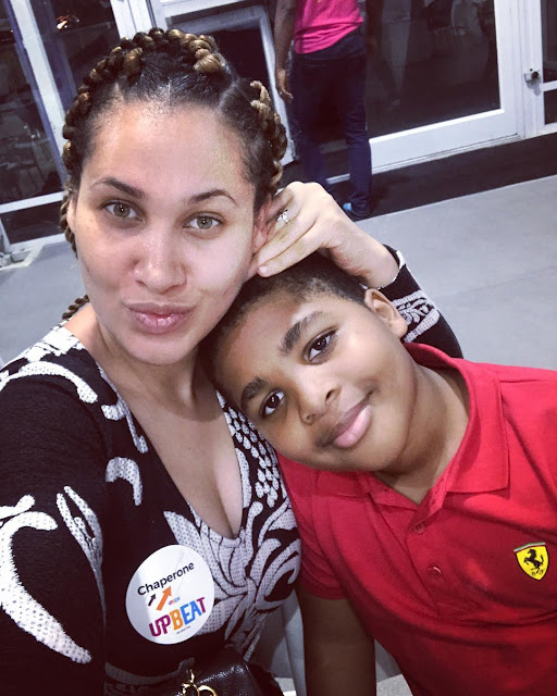 A makeup-free Caroline Danjuma poses with her son