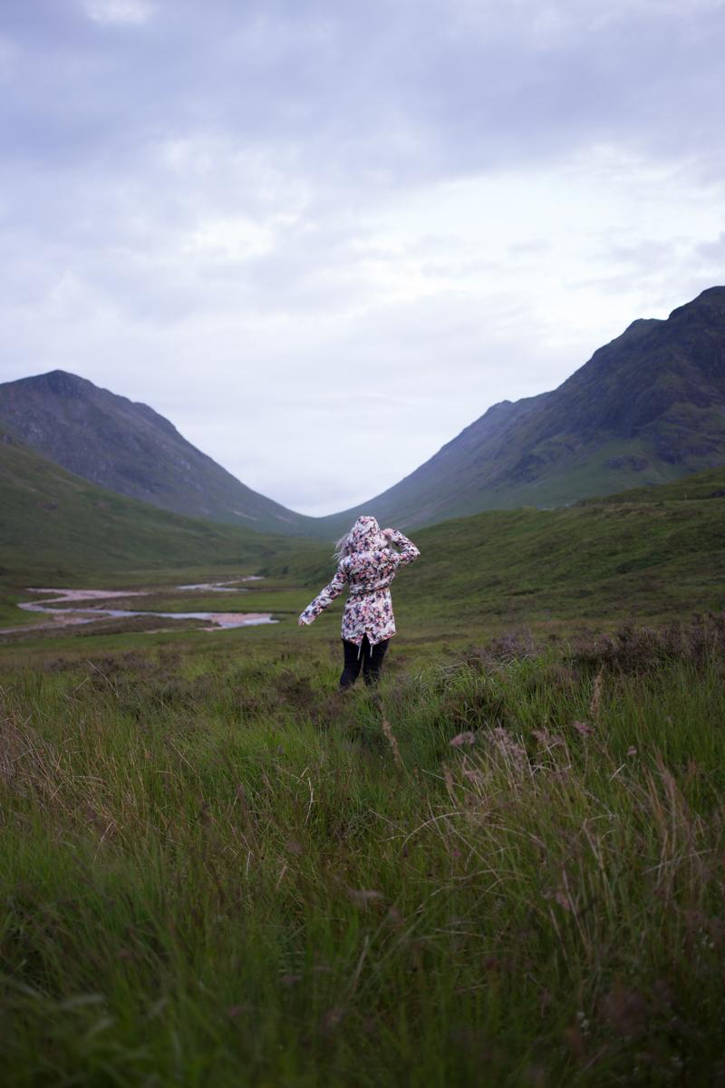 scottish highlands landscape girl hiking mountains