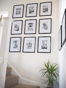 Nine frame gallery wall on stairs and landing