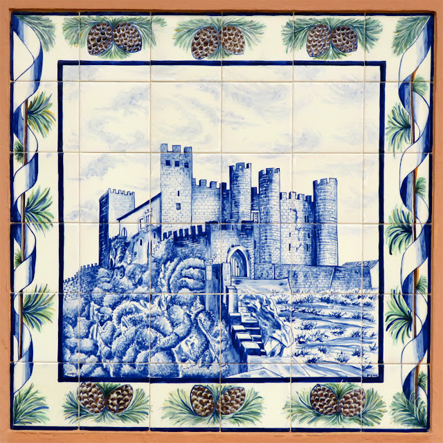 Azulejo in Via Cestoni, representing the Obidos castle, in Portugal, Livorno